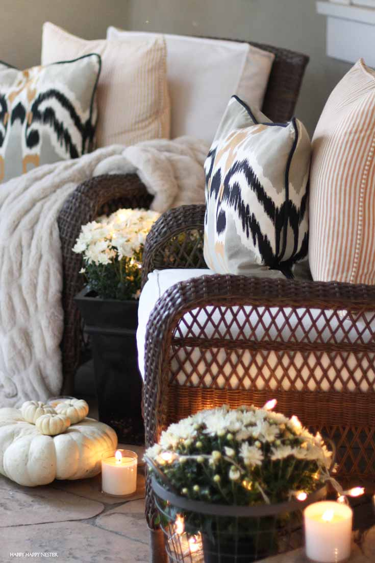 front porch with two chairs and candles lit