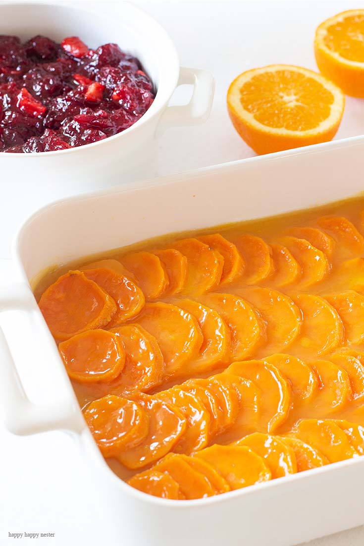 Yams Baked in Orange Sauce is such a delectable, sweet glaze that is irresistible. The citrus is a wonderful addition to the hearty yams. You can baked this in advance by a couple of days. Side Dish | Recipe | Thanksgiving | Vegetable Dish | Holidays | Yam Casserole | Fresh Yams | Comfort Food | Delicious Vegetables