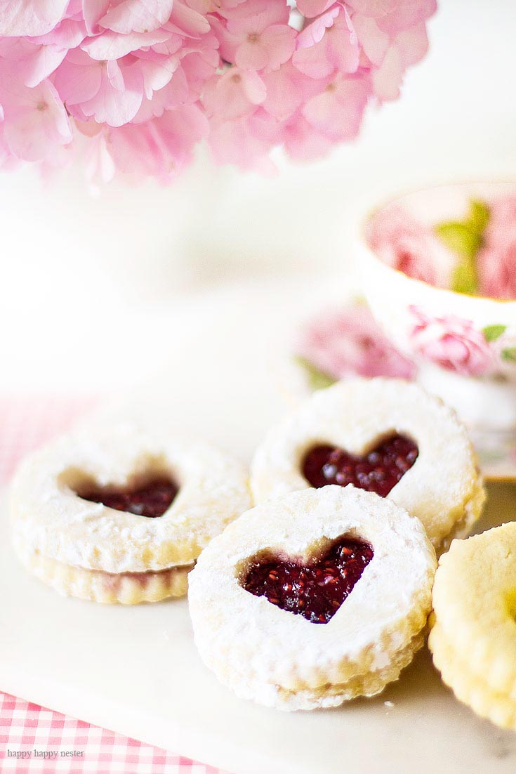 Make these yummy cookies! This Raspberry Filled Valentine's Heart Cookie Recipe is the perfect dessert for a dinner or a party. Give them away as a Valentine's Day gift for a friend. Sprinkle them with powdered sugar for an extra-amazing sugar cookie. Cookie | Baking | Valentine's Day Treats | Cookie Recipe | Raspberry Filled Cookies