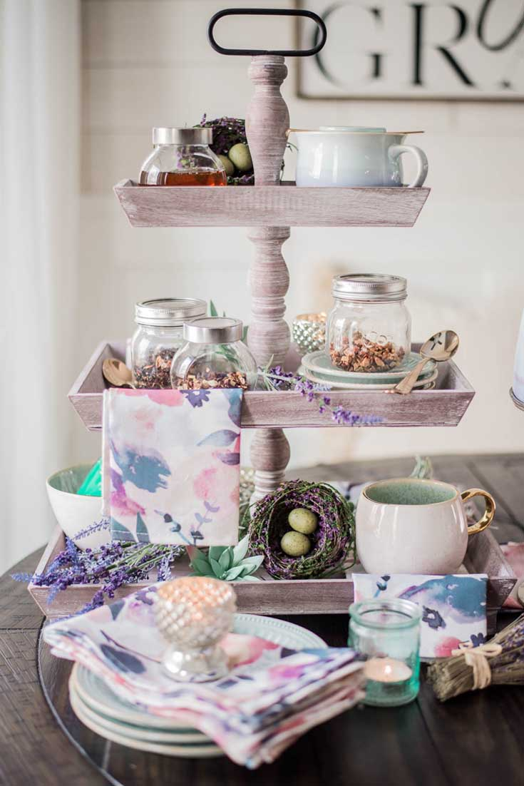 Create a tea station out of a cake stand. Cake stands are easy ways to decorate a table or your home. I have gathered some Cute Ways to Use a Cake Stand that I'm sure you'll love. You can use them for the holidays or even a wedding reception. They add drama and interest because of their styles and heights. #cakestands #decorating #weddings #flowers #decor
