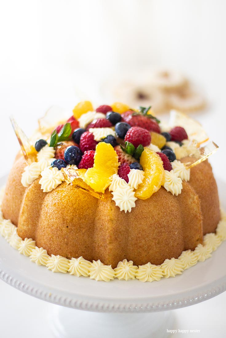The Savarin Cake with fresh fruit. Here is a Yeast Cake Recipe that is soaked thoroughly in an Orange Grand Marnier syrup. This cake is topped with a Sabayon cream frosting and fresh fruit. This unique yeast cake is a bit rustic and very gourmet in taste. It is an impressive cake. Cake | French Cake | Baking | Gourmet Desserts | European Cake