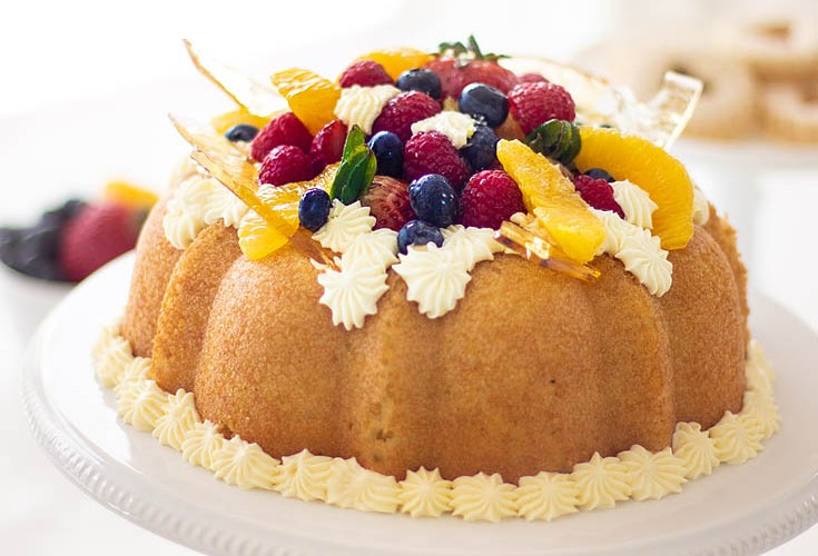 Here is a Yeast Cake Recipe that is soaked thoroughly in an Orange Grand Marnier syrup. This cake is topped with a Sabayon cream frosting and fresh fruit. This unique yeast cake is a bit rustic and very gourmet in taste. It is an impressive cake. Cake   French Cake   Baking   Gourmet Desserts   European Cake