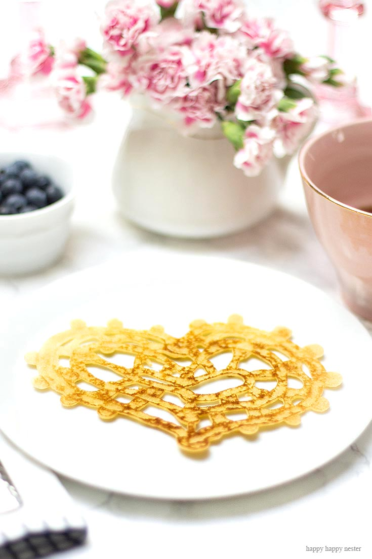 These are seriously the easiest Heart-Shaped Pancakes to make. And if you need some ideas for a Valentine's Day breakfast try making them. Inspired by the lace pancakes on The Great British Baking Show I made them. Not only are they cute, but they also taste yummy. Valentine's Day | Heart Pancakes | Lace Pancakes