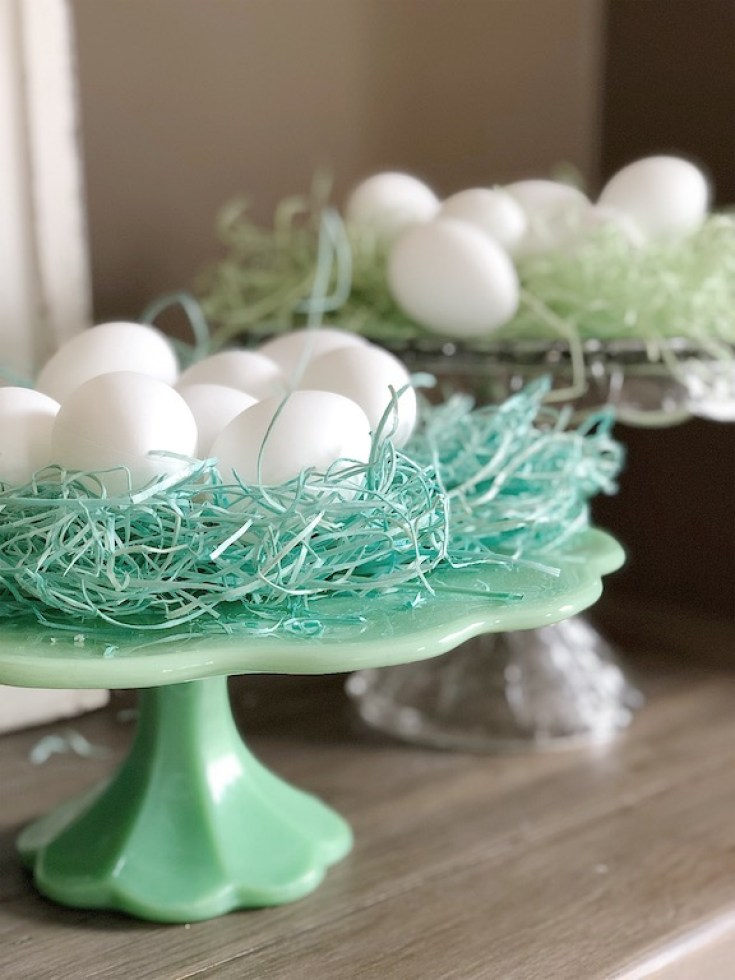 Vintage Classic Cake Stands are used to display holiday decor. Cake stands are easy ways to decorate a table or your home. I have gathered some Cute Ways to Use a Cake Stand that I'm sure you'll love. You can use them for the holidays or even a wedding reception. They add drama and interest because of their styles and heights. #cakestands #decorating #weddings #flowers #decor