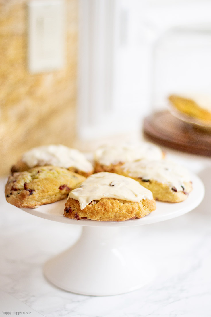 These scones are so easy to make and your family will love them. This Fresh Orange Scone Recipe is the perfect blend of orange and cranberries and a creamy, moist dough. Cold shredded butter and minimal handling of the dough is the key to a fluffy English scone. Orange zest and juice is a delicious pair to cranberries. #baking #scones #joannagaines #favoriterecipes #englishscones