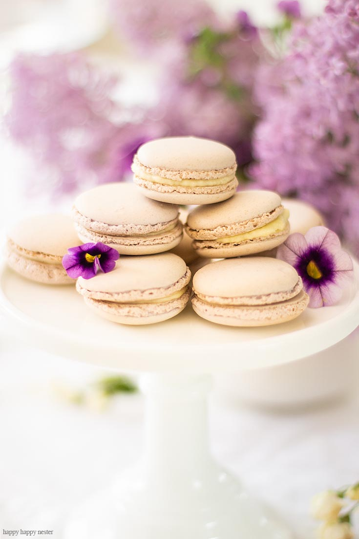 These yummy french macaron cookies are just a few items on this beautiful spring table. It doesn't take much to create a Beautiful Spring Table with Fresh Flowers. This spring table with fresh lilacs and other garden flowers is so easy to create. No need to spend much to style a fabulous spring table. #springtable #flowerbouquet #freshflowers #lilacs #lavendertable #decoratingwithlilacs #purplelilacs