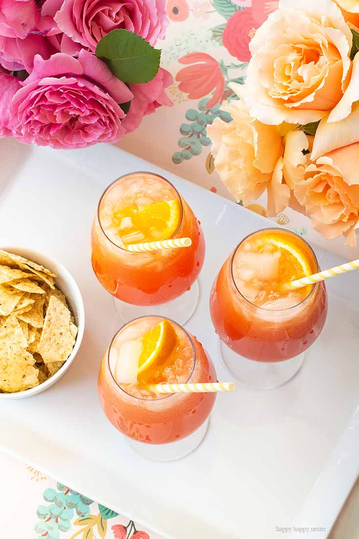 Enjoy this wonderful drink. This Simple Punch Recipe for Mother's Day. Make this easy drink for special occasions or any party. Make it with rum or as a non-alcoholic drink. This Planters Punch drink has pineapple, orange juice, and grenadine in the ingredients. #drinks #cocktails #punch #weddings #weddingparty #rum #planterpunch #mocktails
