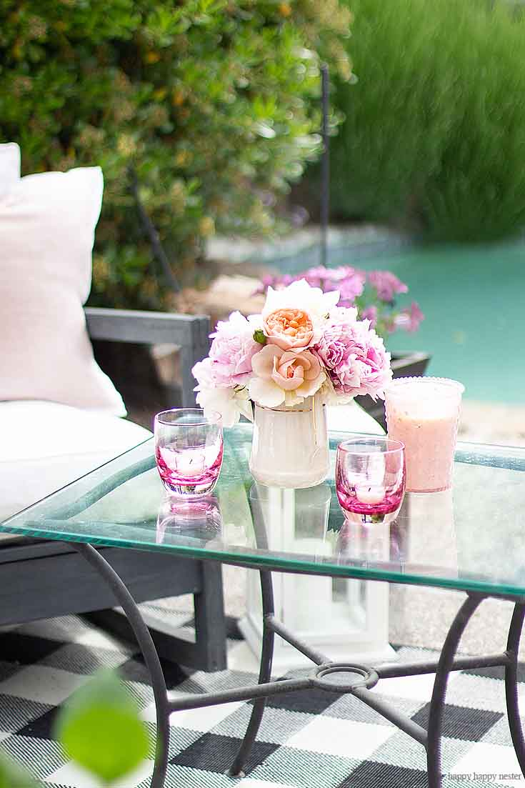 Enjoy your gardens flowers and display them when entertaining for the summer. And learn Learn How to Create a Cozy Outdoor Living Space in 9 easy tips. This DIY to summer decorating is essential. #summerdecor #outdoorlivingspaces #entertaining