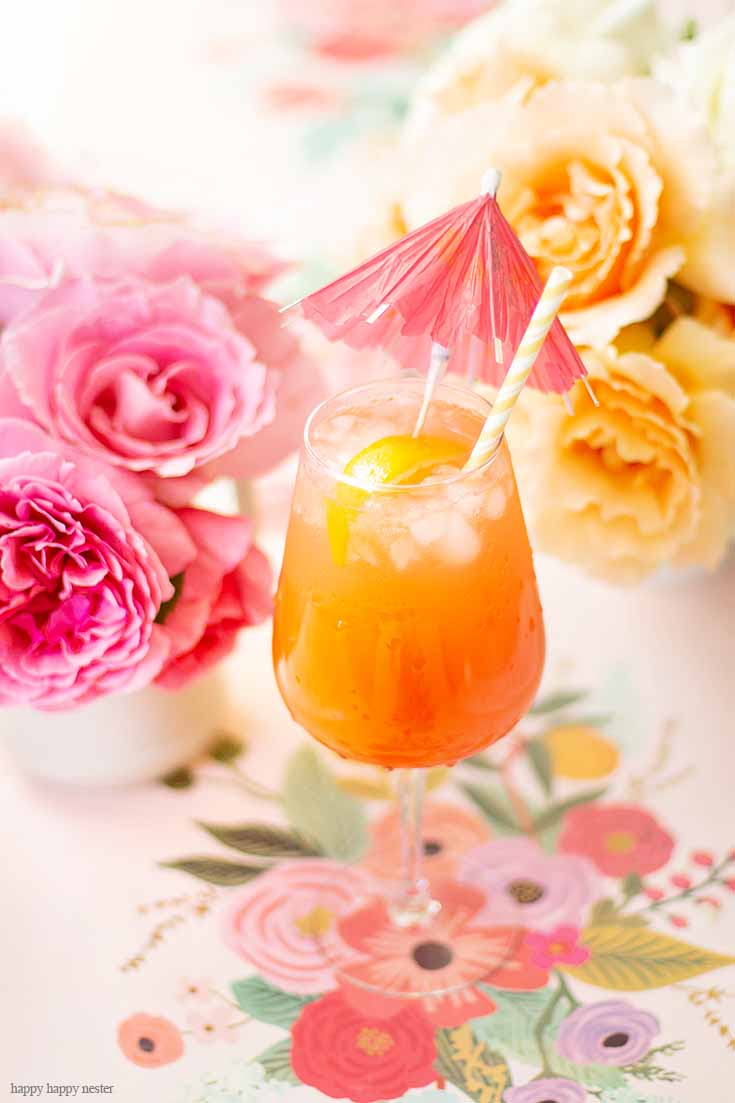 This wonderful simple punch recipe for Mother's Day is good all year round. This an easy recipe and only requires a few ingredients a few minutes to make. Add rum or make it an alcohol-free drink. I believe this cocktail is called a Planter's Punch that is refreshing and yummy. #cocktails #mocktails #drinks #drinkrecipes #recipes #summerdrinks #fruitdrinks