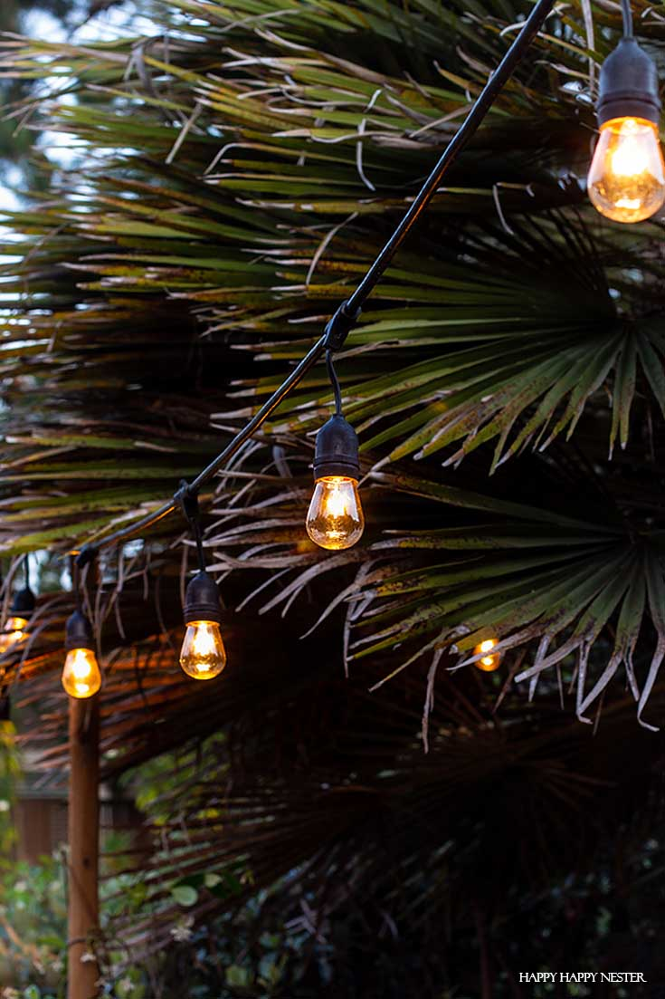 Learn the tricks on how to Hang Outdoor String LIghts in cement supports. This technique and DIY is a solid solution. Also, the light poles are easy to install and are quite stable. #DIY #outdoorlights #patios #gardenprojects