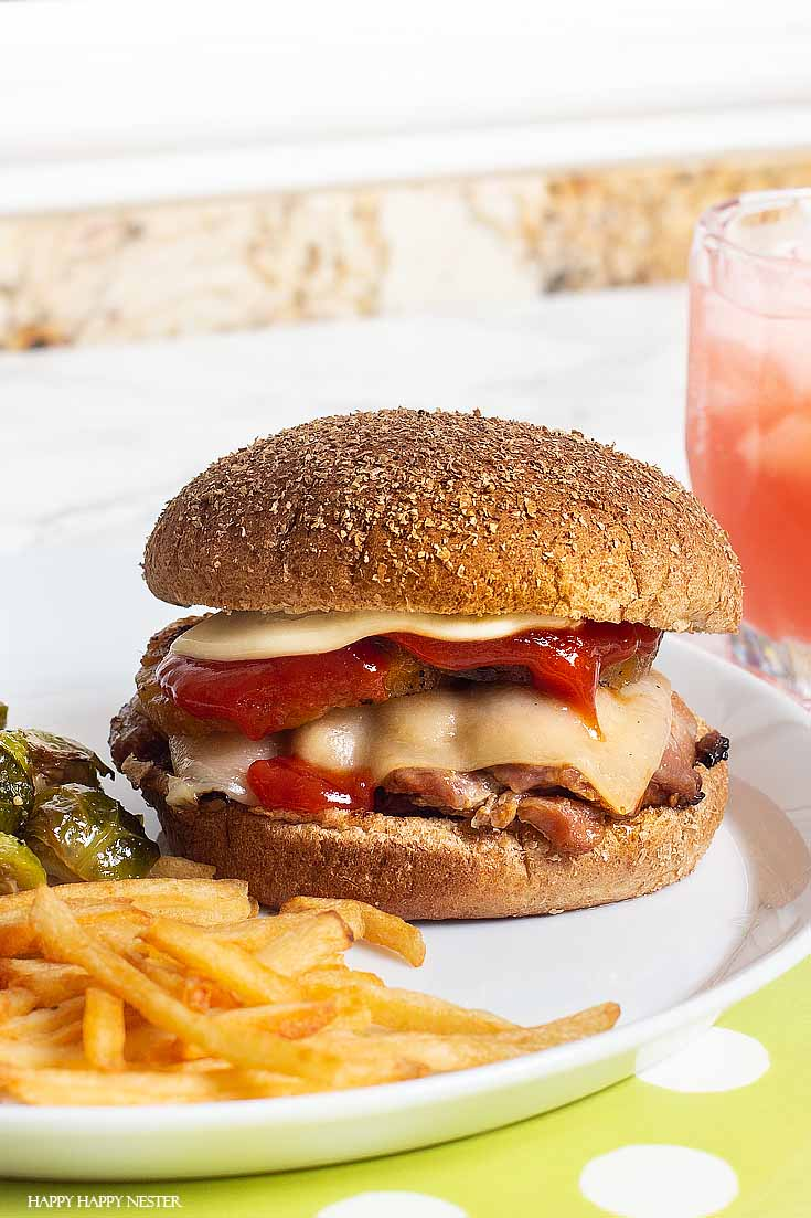 This easy Chicken Teriyaki Grilled Burgers recipe is inspired by Red Robin's burger. The chicken is topped with pineapple and cheese which makes it yummy. #burger #bbq #recipes