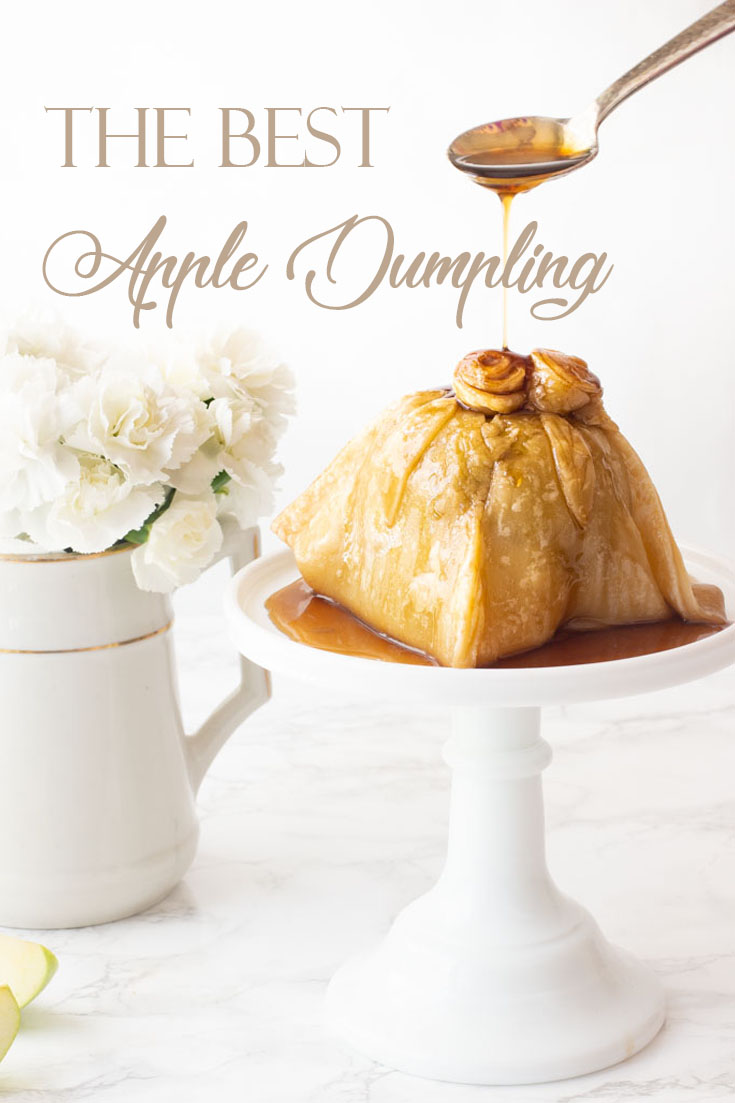 This Easy Apple Dumpling Dessert with Caramel Sauce is so delicious. The apple has sugared nuts inside the core and is topped with a pastry dough covered in a yummy caramel sauce. #dessert #appledumpling #appledesserts