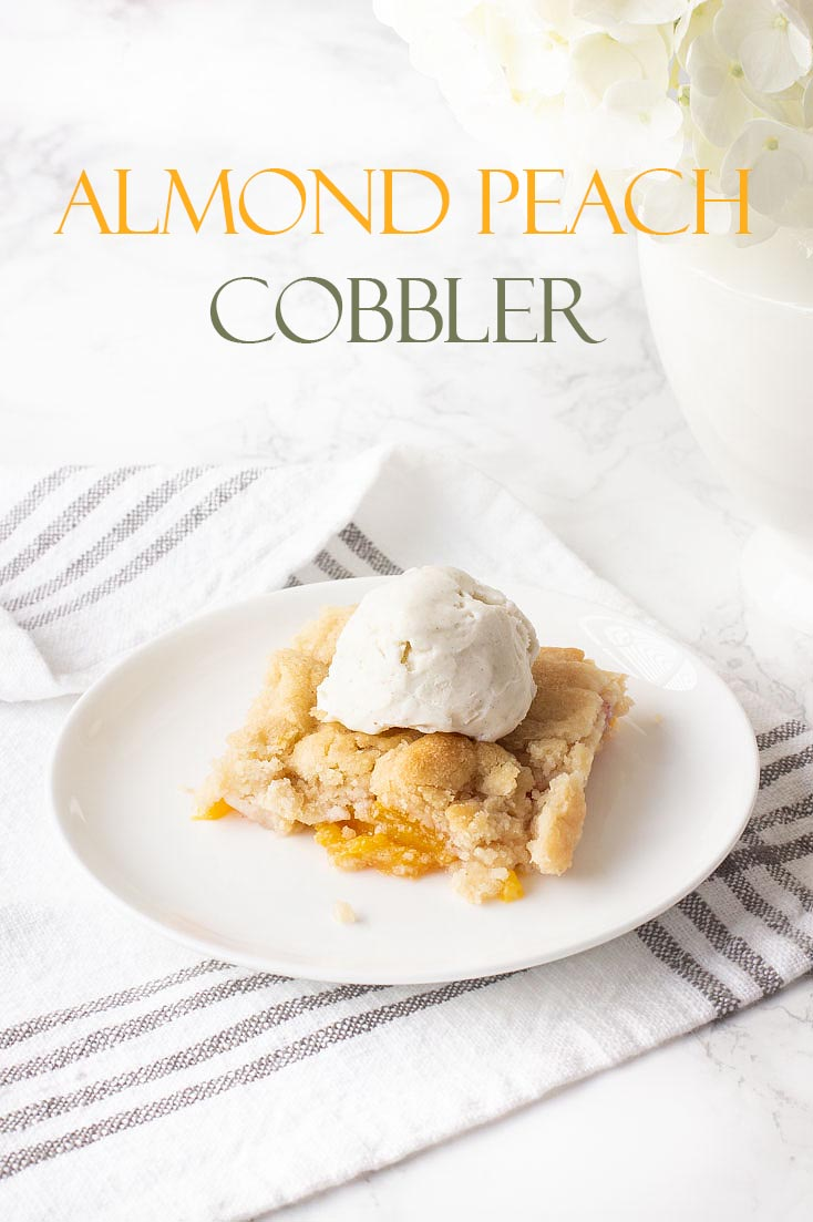 This Peach Cobbler with Almond Cookie Dough is a delightful and subtle blend of almond and peaches. It is a new twist to a summer dessert of fresh fruit. #peachcobbler #recipe #desserts #freshfruitrecipe