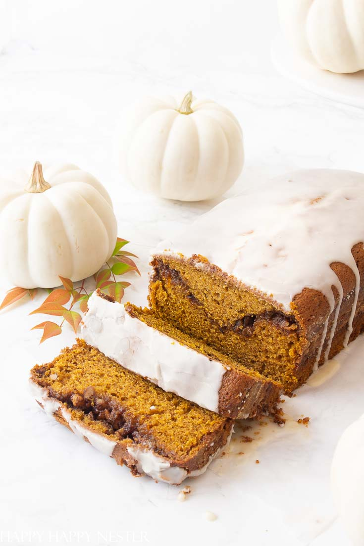 This Moist Pumpkin Bread Recipe has a cinnamon, sugar and nut swirl in the middle and topped with icing. Also, this pumpkin bread is easy to make and yummy.