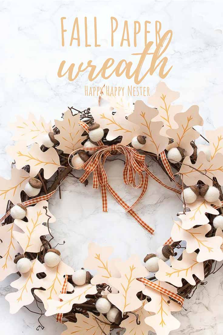 Need some Fall Wreath Ideas DIY? This paper wreath DIY is so easy to make, and the results are pretty. Not only is this a simple wreath to make it is pretty inexpensive since it requires paper leaves. #crafts #papercrafts #fallwreath #wreaths