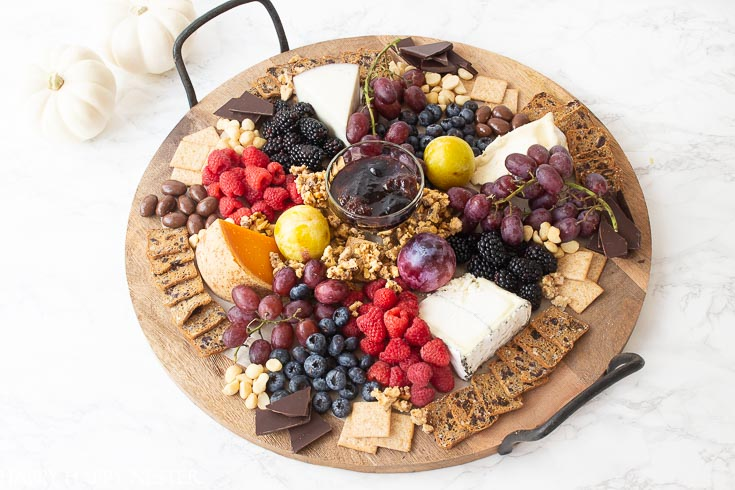Need some Easy Appetizer Ideas for a Party, then you'll want to view this step by step tutorial. It shows how to build a fruit, cheese charcuterie board. #charcuterieboards #entertaining #partyappetizers #appetizers #appetizerdiy