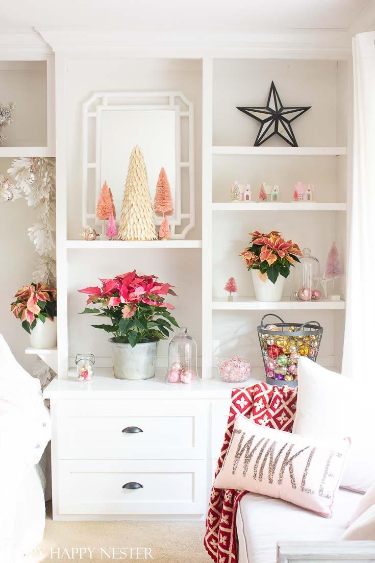 If you love pink and red then check out this great post. Easy Vintage Christmas Bedroom Decor is a bright and pink winter wonderland. It's a fun and happy room decked out in vintage ornaments and pink poinsettias. #christmasbedroom #craneandcanopybedding #Christmasdecor #vintagedecor