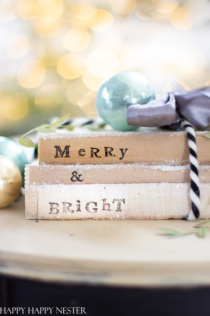 This easy Christmas Craft project is so fun to make. I love that you can recycle your old books and bring them back to life. This Christmas make sure to gather up your old books and create this cute holiday decor. #crafts #holidaycrafts #christmascraft #oldbooks