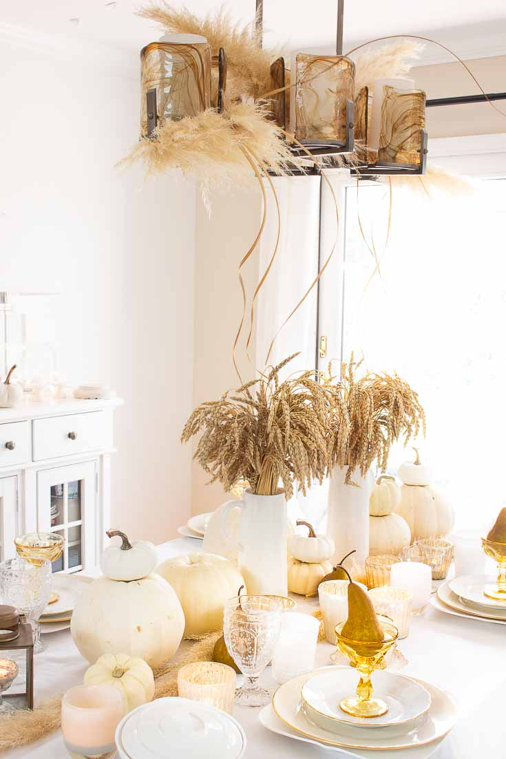 Here is a Thanksgiving Table Setting Made Easy. Find out how to set a Thanksgiving table step by step. Wheat makes a beautiful fall centerpiece for a table. #thanksgiving #thanksgivingtable #tabledecor #createathanksgivingtable #tablesetting