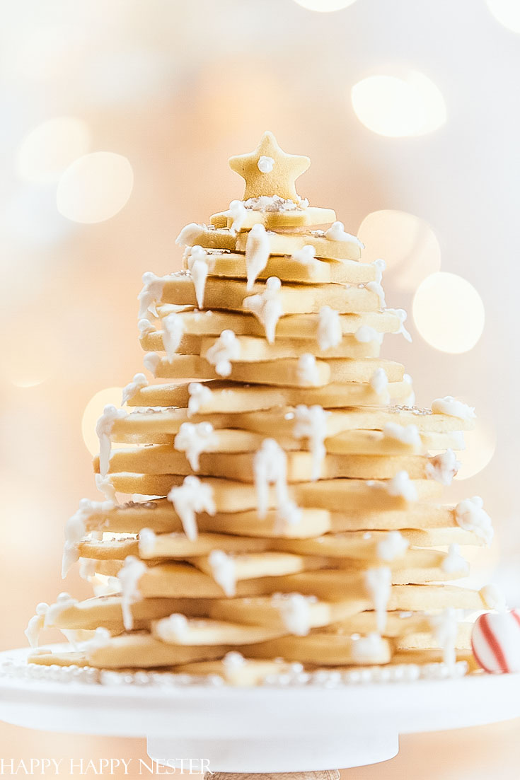 This yummy sugar Christmas cookie recipe is the perfect cookie for creating this fun tree. Learn how to make this impressive dessert for a special dinner party or as a hostess gift. This special treat will impress your family and friends! #christmasbaking #baking #cookies #christmascookies #sugarcookies
