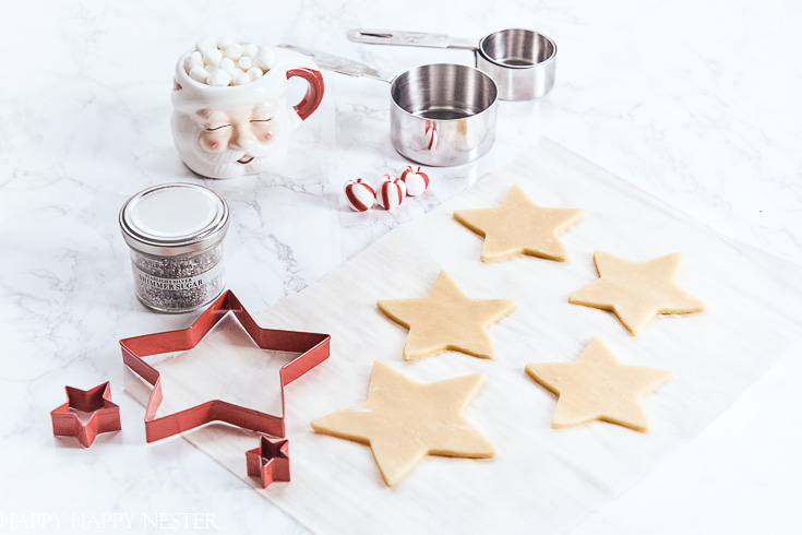Learn how this Christmas cookie recipe is the best cookie for creating a fun and pretty cookie tree. #surlatable #christmascookies #sugarcookierecipe #cookierecipe #cookietree