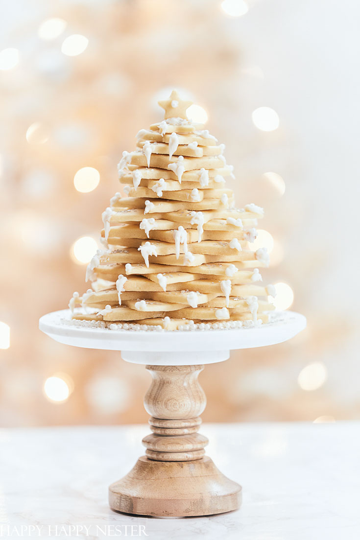 This sugar Christmas cookie recipe is the perfect cookie for creating this fun tree. Make this impressive dessert for a special dinner party or as a hostess gift. This special treat will impress your family and friends! #christmasbaking #baking #cookies #christmascookies #sugarcookies