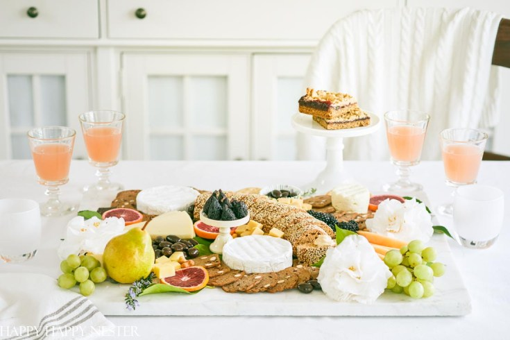 This Charcuterie Board tutorial will help you design your next appetizer. Roundup your favorite crackers, slices of bread, fruits, cheeses, and chocolates to create this platter of yummy appetizers. In no time, you'll have the best ever charcuterie board to serve to family and friends. #charcuterieboard #appetizers