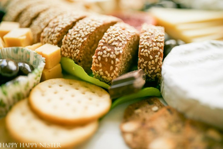 This Charcuterie Board tutorial will help you design your next appetizer. No need to stress if you roundup your favorite crackers, slices of bread, fruits, cheeses, and chocolates. In no time, you'll have the best ever charcuterie board to serve to family and friends. #charcuterieboard #appetizers