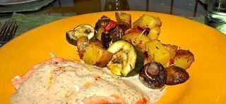 Salmon with dill sauce and roasted vegetables