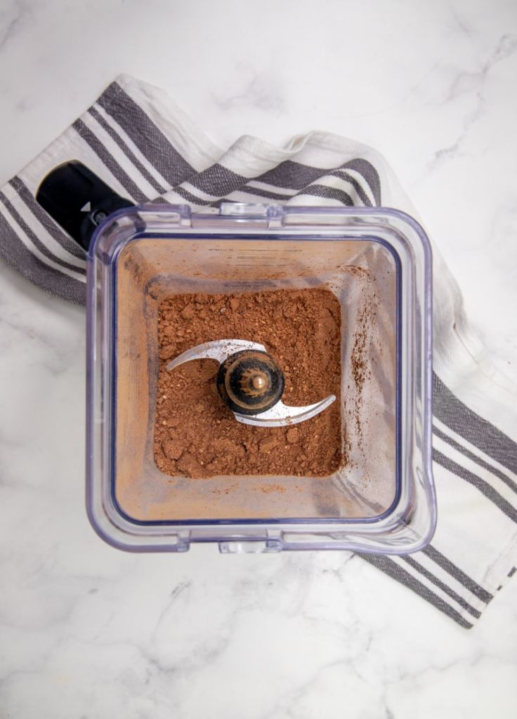 overhead shot of a blender with cocoa powder