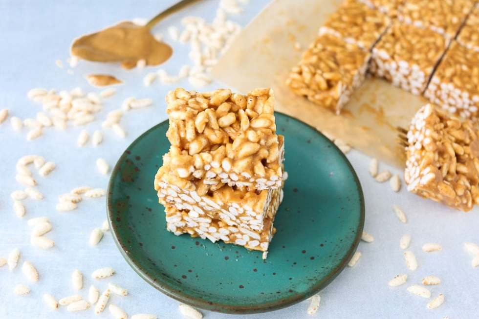 Healthier Than Rice Krispy Treats- peanut butter cereal bars recipe stacked on a plate