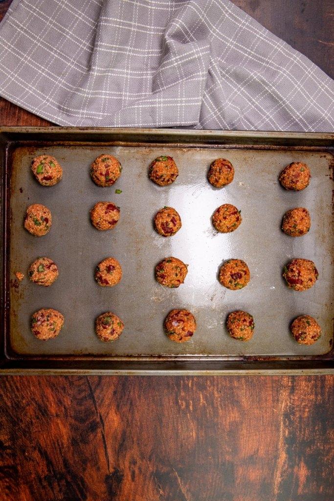 quinoa pizza balls on a b baking sheet