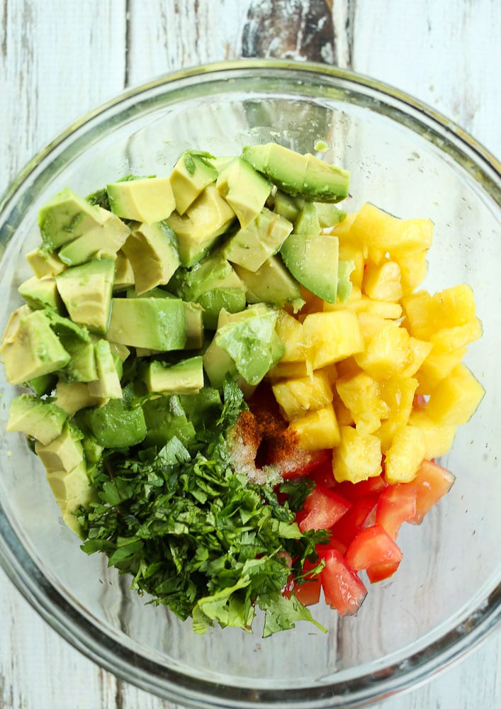 ingredients for pineapple avocado salsa in a bowl