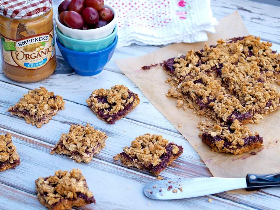 Peanut Butter and Jelly Oatmeal Bars--these quick and easy breakfast bars will please the PB&J lover in your life! Dairy free, gluten free, almost vegan, no refined sugar