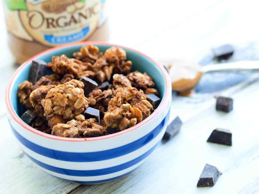 This Peanut Butter Chocolate Chunk Granola recipe is super crunchy and has big chunks! No refined sugar with intense peanut butter flavor. Great homemade granola recipe!