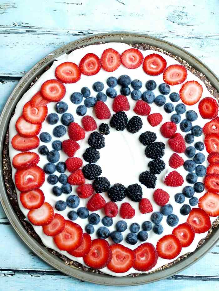 Easy Fresh Fruit No Bake Dessert PIzza Recipe. This is a clean-eating recipe with all real foods! A special treat that is perfect for the 4th of July desserts or any time of the summer! #dessert #fruitpizza #nobake #healthy #glutenfree #4thofjuly #memorialday #redwhiteandblue #patrioticdessert
