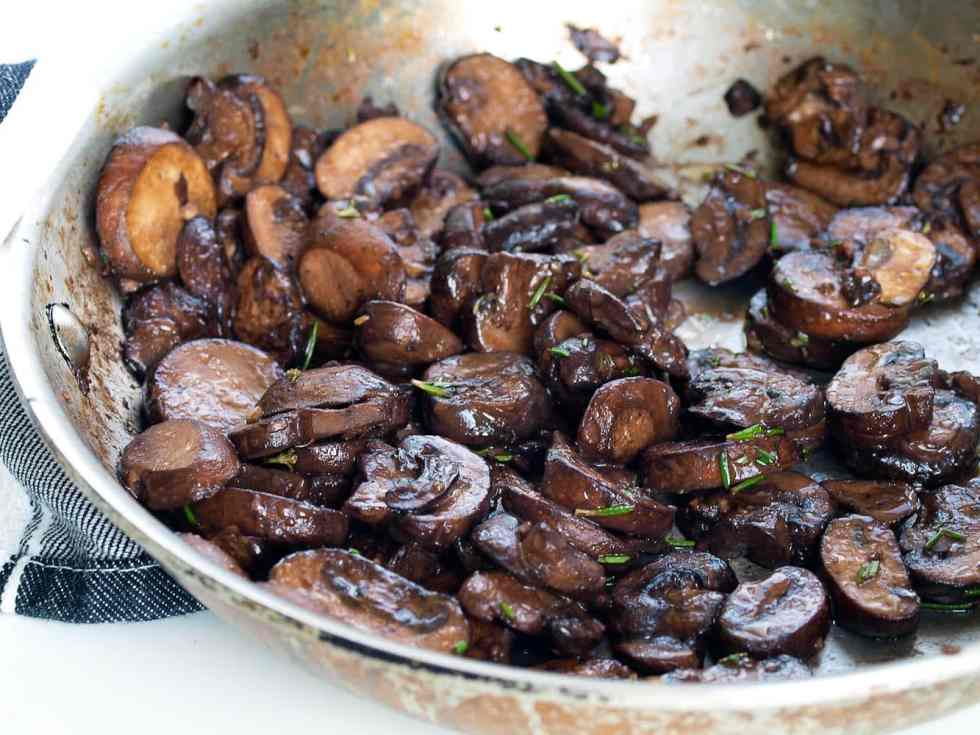Mushroom Sauté with Rosemary, Garlic, and Red Wine. This is a quick and easy side dish recipe OR serve it over a bed of polenta for a great vegetarian or vegan main course. Delicious!