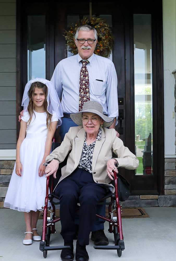 Meghan with Grammy and Papa first communion