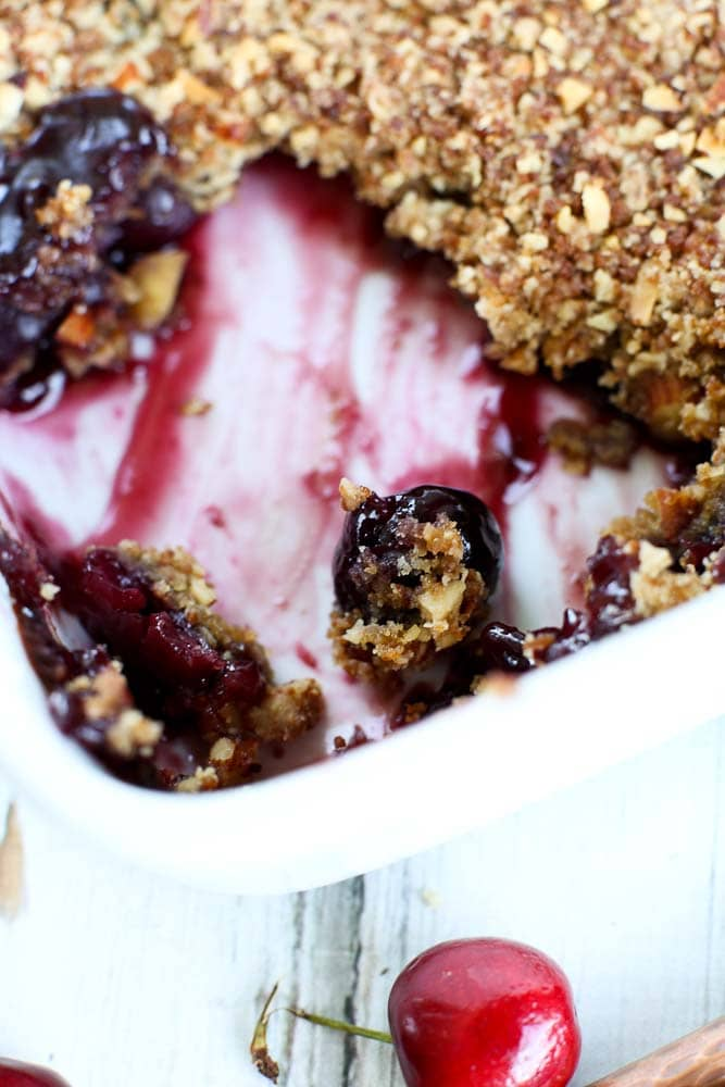 Fresh Cherry Crumble Recipe--close up of the baking dish with a portion removed