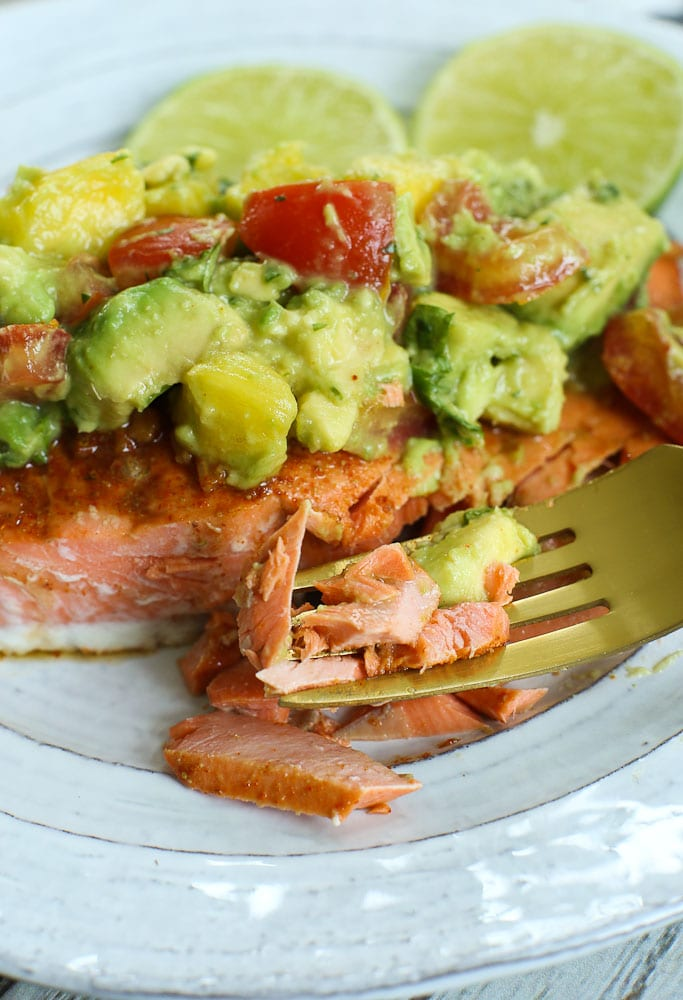 Close up of Chili Lime Baked salmon recipe with avocado pineapple salsa on top