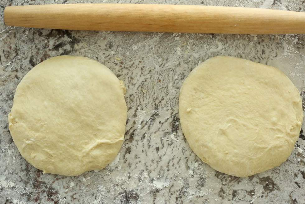 Perfect Bread Machine Dinner Rolls--two dough circles with a rolling pin