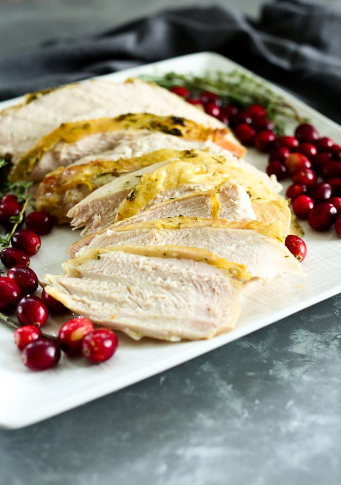 Butter and Herb Roasted Turkey Breast Recipe presented on a platter