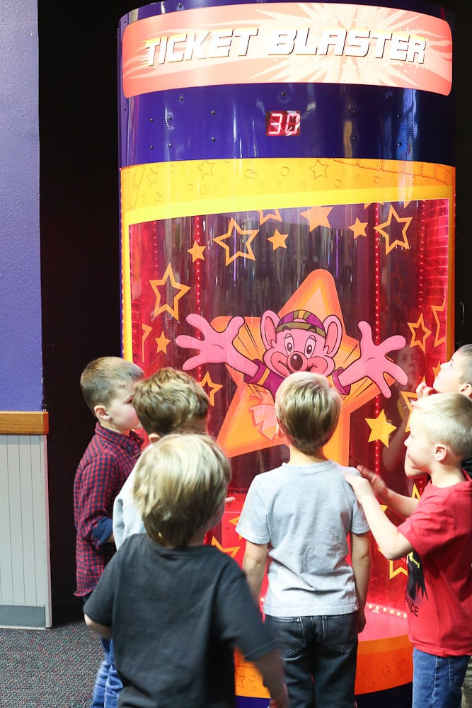 Luke's 6th Birthday Party at Chuck E Cheese's-looking at the Magic Ticket Blaster
