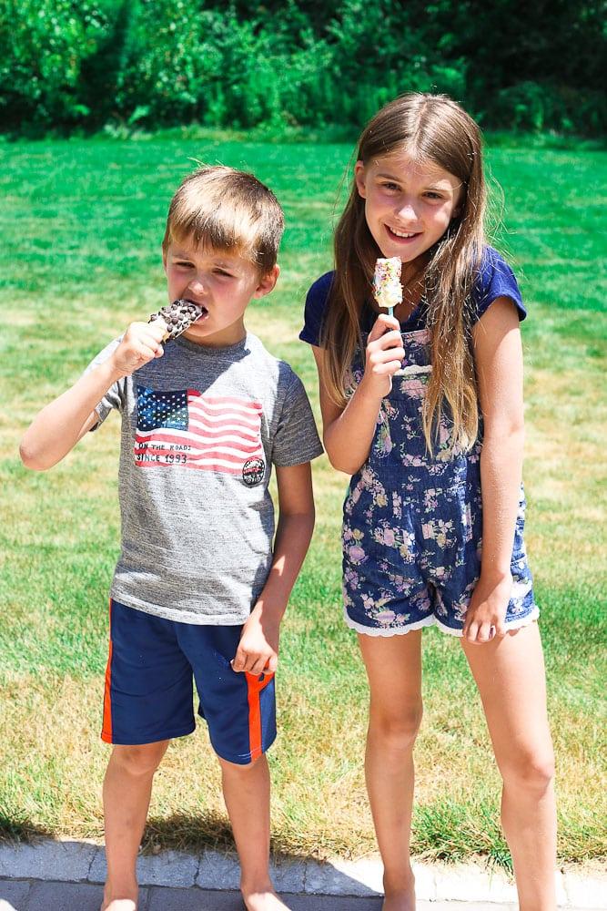 Greek Yogurt Frozen Banana Pops kids eating them