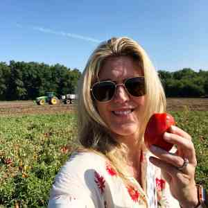 Are Canned Foods Nutritious? (holding a tomato at Triple s farm )