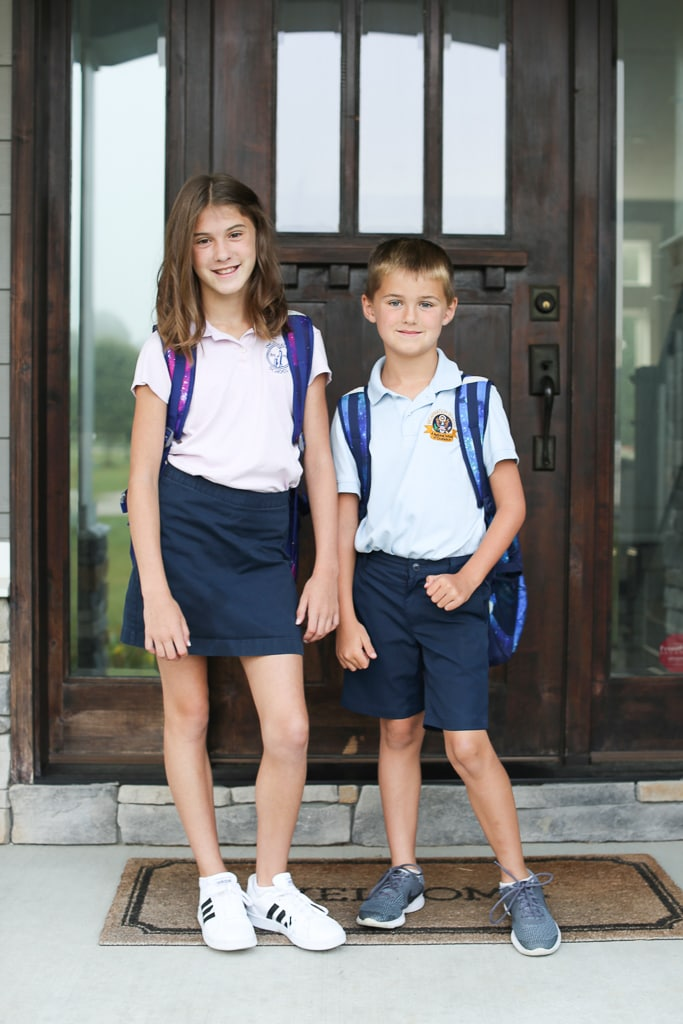 Meghan and Luke first day of school 2019 in front of door