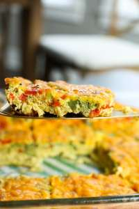 Easy Breakfast Egg Casserole recipe one slice on a spatula