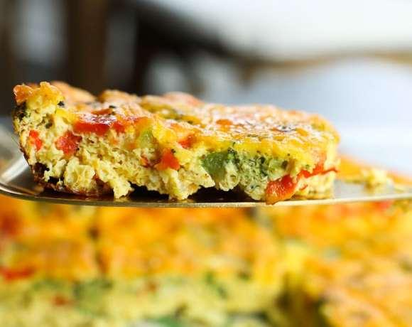 Easy Breakfast Egg Casserole recipe one slice on a spatula