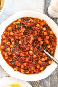 Marinara Sauce with Chickpeas and Kale recipe--in a large bowl with a spoon