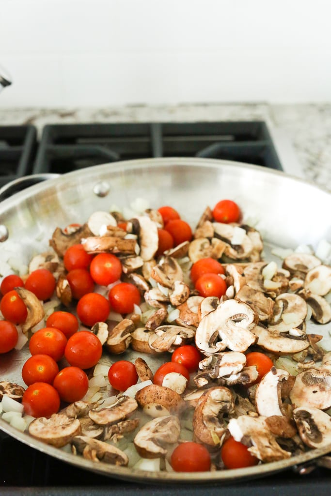 mushrooms and grape tomatoes in a large skillet